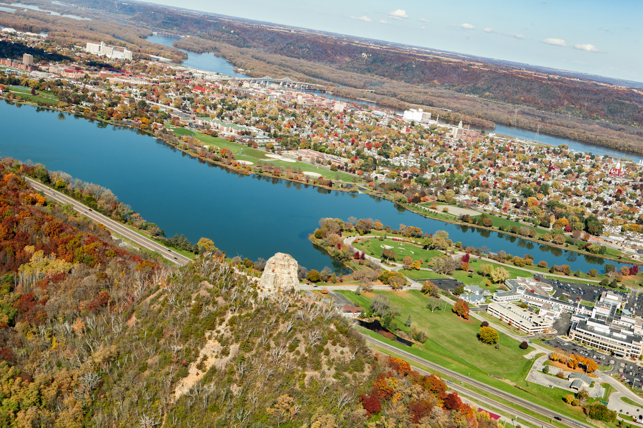 An aerial view of Winona shows Sugar Loaf rising high above the city