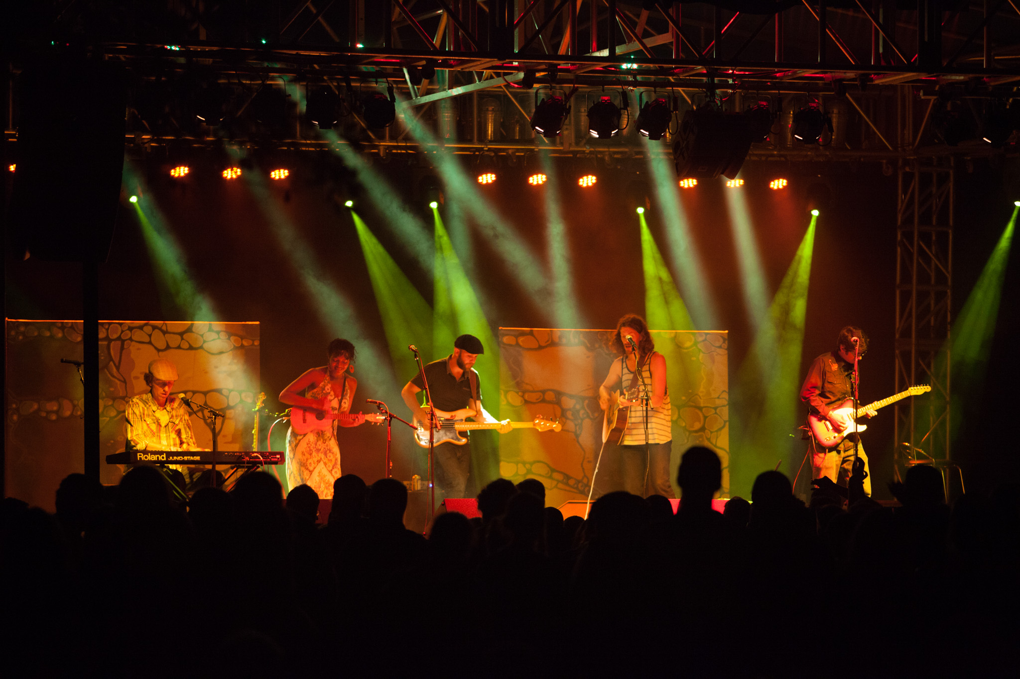 A national bluegrass band performs under big stage lights at Boats and Bluegrass