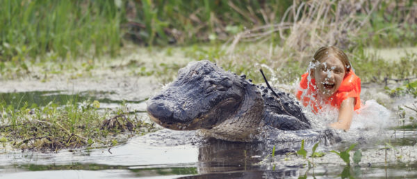 girl riding alligator