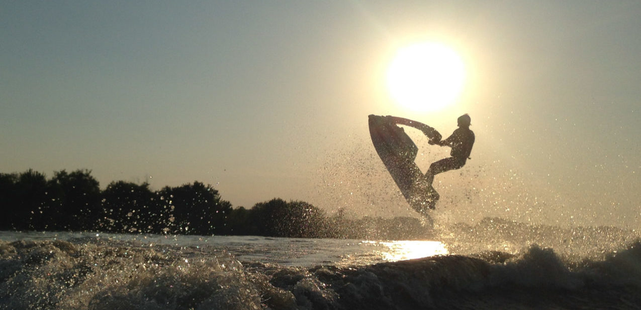 silhouette of jetski jumping from water